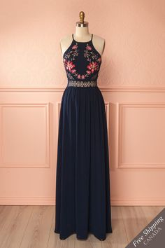 Ailen Navy #boutique1861 / Like a woodland fairy, you will emanate grace and joy in wearing this long dress with its skirt that falls to the ground. The colourful embroidery and crocheted lace cut-outs at the waist will give you a delicate and springtime allure. Decorate your hair with flowers and slip on simple sandals for a free and natural look.