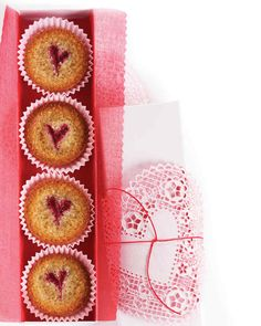 Raspberry-Almond Financiers | Martha Stewart Living - These petits fours conceal a honeyed, cakey interior beneath a crisp, crackly surface embellished by hand with hearts of jam. They're perfect as a homemade gift for Mom or for serving to guests at a Mother's Day celebration.