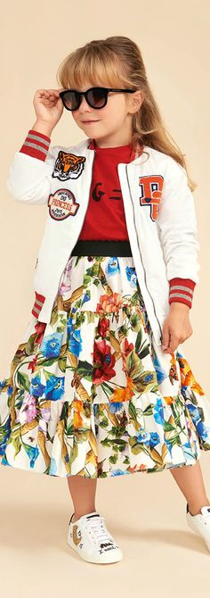 DOLCE & GABBANA Girls Mini Me Fiori Rampicanti Flower Print Skirt & White Varsity Sweater from the Spring Summer Collection. Love this delightfully pretty mini me look Inspired by the D&G Women's Collection. Perfect Summer Streetwear Look for a little princess. Pretty Summer Look for a stylish kid, tween and teen girls. #dolcegabbana #girlsdresses #kidsfashion #fashionkids #childrensclothing #girlsclothes #girlsclothing #girlsfashion