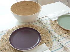 natural open raffia mats over regular placemats. love the combination.