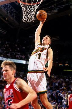 Detlef Schrempf of the Seattle SuperSonics attempts a dunk against Steve  Kerr of the Chicago Bulls in Game Four of the 1996 NBA Finals at Key Arena.