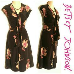 Betsey Johnson Floral Silk Dress sz 8 Beautiful Betsey Johnson Silk Dress in size 8. Black with pink and tan lillies. Dry clean only. Built in scarf can be tied several ways around the neck. Beautiful quality and in great condition! Betsey Johnson Dresses