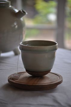 Ceramic tea cup and African Mahogany saucer #ideamongery #wemakethings
