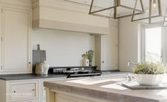 Coastal Retreat, a Classic Kitchen by AndrewRyan.ie. Craftsmanship since 1973.  Weathered Oak worktop