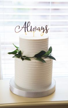 This wedding cake topper simply states Always for an utterly romantic dessert table statement. This cake topper is available in gold mirror as pictured, natural wood for a vintage type feel, or a variety of acrylic colors including beautiful glitter. This wedding cake topper is sure to impress. Choose your material choice when adding to your cart. There are so many options for this lovely cake topper. Cake Topper Size: 6 wide, long stick so versatile with cake style. Each cake topper is…
