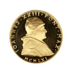 Pope John XXIII Medal. Medal with profile of Pope John XXIII facing proper right on obverse, and a landscape and village or monastery on reverse. This medal was struck on the 80th birthday of Pope John XXIII.  - John F. Kennedy Presidential Library & Museum