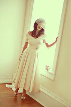 A beautiful bride in a vintage 1950's Cahill Wedding Dress