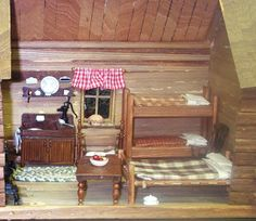 The interior of a pioneer's log cabin in dollhouse scale. - Photo Courtesy Betty Bonney copyright 2008 Used with Permission Miniature Rooms, Miniature Kitchen, Miniature Crafts, Miniature Houses, Cabin Dollhouse, Dollhouse Miniatures, Barbie Furniture, Dollhouse Furniture, Dollhouse Interiors