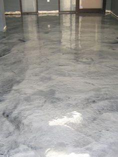 Metallic silver concrete floor at Boulder, Colorado tech consulting company. Metallic pigments in polyaspartic floor coating.