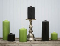 Arrange the best Halloween chic displays by pairing our black pillar candles with our fresh green pillar candles and silver candle holders.