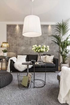 This modern urban glam apartment was decorated with a black and neutral gray palette, accented with gold and white cream fur blankets and pillows. Black Carpet Living Room, Black Sofa Living Room Decor, Black And White Living Room, Elegant Living Room, Chic Living Room, Living Room Paint, Small Living Rooms, Living Room Sofa, Living Room Interior