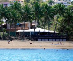 "Tamboo Tavern, Rincon, Puerto Rico. ""Simply one of the most romantic, sultry beach bars imaginable. Owner Javier Quinones and his wife had their first date here in 1990. They now serve everyone from wedding guests in formal attire to sunburned yuppies in bathing suits. Sit on the beachfront deck with a drink and watch for whales, play footsie in the sand with your loved one, and welcome the evening with hot Latin rhythms."""