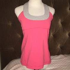 Lululemon Sz 10 scoop tank In great condition, worn gently no major signs of wear. Hot pink with a blue/white striped scoop neck. No trades. lululemon athletica Tops