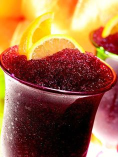 Frosted Red...8 oz. red wine  10 raspberries  10 strawberries  1 orange  1 lemon  Ice