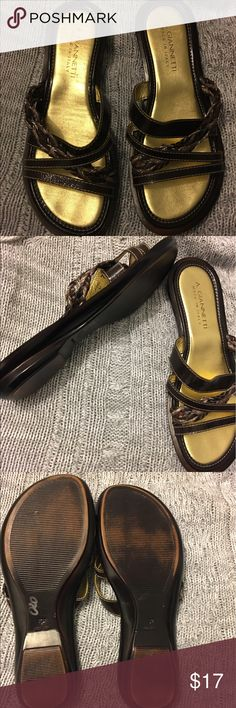 Brown leather sandals-Made in Italy Great used condition.   These are brown, they just look black in the pictures due to lighting.  Leather upper, man made material for sole.   Very nice shoes! A. GIANNETTI Shoes Sandals