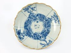 A rare Arita blue and white Dish, c.1830, a hare and waves