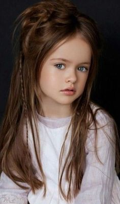 Russian child model Kristina Pimenova. So pretty, but each pic she is in her hair and eyes are different colours and she is altered by makeup. Sad that kids have to be subjected to that