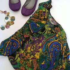 """GONE 10/1 ⏰ Body Central Floral Paisley Romper 😱Closet Closing Today!! Last Chance!! 😱 🎁FREE Item With Bundle!🎁  Paisley floral print in a strapless one shoulder silhouette! Ruffle trim neckline. Pull on construction. Elastic smocked waist. Makes a great cover-up! Vibrant colors! Excellent preloved condition!  **Last photo is stock image in a different print used to show fit & style. Actual romper pics 1-3.  { Materials } 100% Rayon   { Measurements } Bust: 18"""" Waist: 11-16"""" Length: 32""""…"""