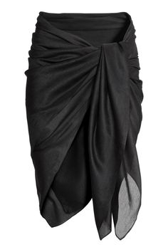 Black. Sarong in airy woven fabric. Size 55 x 59 in.