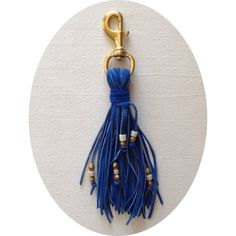 Den  Delve. Keychain or bag adornment in blue suede with African beads and hammered metal. Handmade in L.A.
