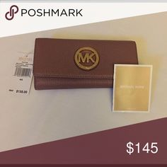 Michael Kors wallet Brand new with tags, color is dusty rose comes with care booklet. Michael Kors Bags Wallets