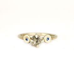 Rough diamond ring with blue sapphires