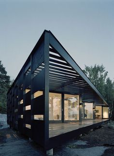 Tham & Videgård Arkitekter designed this geometrically shaped house located in the Stockholm Archipelago of Sweden.