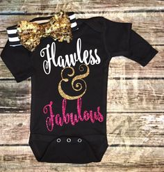 A personal favorite from my Etsy shop https://www.etsy.com/listing/263106273/baby-girl-sparkle-onesie-flawless-onesie