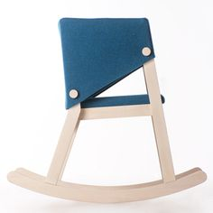 A single piece of felt wraps around the back and armrests of this solid wooden rocking chair by Rome designer Giancarlo Cutello.