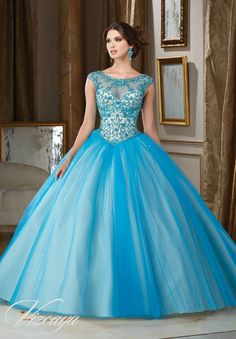 Tulle Quinceañera Ballgown with Beaded Illusion Neckline. Matching Stole. Corset Back. Colors Available: Peacock/Champagne, Cotton Candy/Champagne, White