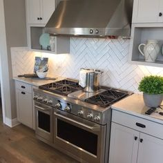 My friend Anna & her husband Phil recently completed an absolutely AMAZING  kitchen renovation and I cannot wait to share it with you! My jaw hit the  floor when I saw these beautiful pictures she posted of the transformation.  The white cabinets, the hardware, the backsplash, THE SINK! It is