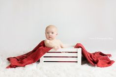 Look at this chubby baby! isn't he the cutest? He was so good during his indoor photo session! Red blankets and white crates are always the best prop!