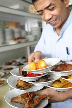 Wonderful Indonesia - Padang Food (you can see so many plates in just two hands like this in almost any Padang Restaurant!)