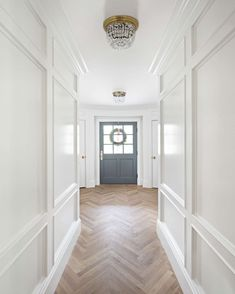 10 Gorgeous Timeless Design Ideas {The Fox Group} Herringbone flooring and beautiful paneled walls painted Benjamin Moore Simply White. The Fox Group. The post 10 Gorgeous Timeless Design Ideas {The Fox Group} appeared first on Wood Diy. White Paint Colors, White Paints, Planchers En Chevrons, Casa Feng Shui, Stairway Lighting, Entryway Lighting, Kitchen Lighting, Flur Design, Hall Design