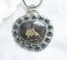 First Known Wet Plate Collodion Image Shot In Camera On Precious Blue Sapphire surrounded with smaller Sapphires in sterling and Fine Silver By: Angie Pember Brockey