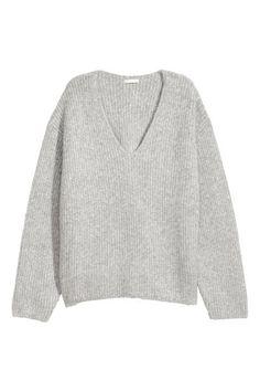 Pull en douce maille côtelée enrichie d une touche de laine. Modèle ample  avec 5e6b7858aeae