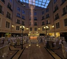 Atrium with night lights: cozy atmosphere, sparkling lights, fascinating reflections.