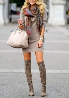 Fall fashion trends. Skirt, long boots and scarf.: