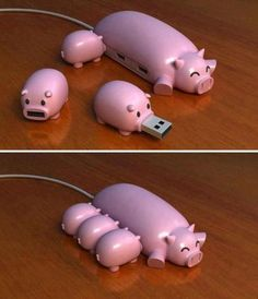 Piglet flash drives with momma pig dock