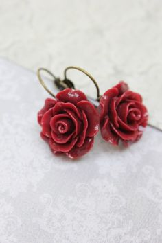 These are classic lever back earrings with beautiful deep red rose drops! The these elegant blooms have lovely ruffled details. These earrings