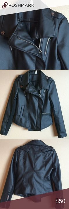 Vegan NWOT Black Moto Jacket Vegan NWOT Black Moto Jacket Size Med Bustline 17 inches Length 23 inches. Zipper closure, 2 pockets 1 open 1 zip closure, cuffs of each sleeve have zipper, 1 zippers on each side of chest, but no pocket there. faux button snap closure on shoulders. Miranda & Mocha  Jackets & Coats