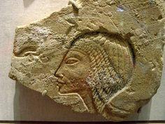 Nefertiti under the Aten, wearing Nubian wig. Amarna Egypt.