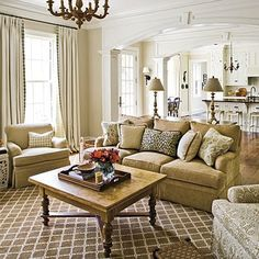 neutral family rooms | LOVE the white woodwork and moldings in this home.