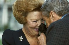 Queen Beatrix and prince Claus cuddling their dog.