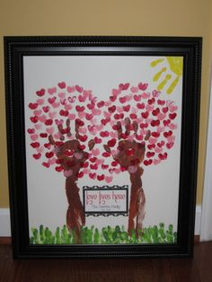 "Love this!  Valentine's Day Handprint Art with Handprint Trees & Sun.  Fingerprint Heart Leaves.  Scalloped heart frame surrounding ""Love Lives Here"" with family name & date family was established."