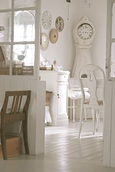 white floors with Swedish Mora clock and extra face plates...I'm in love!