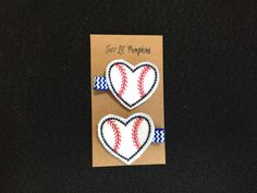 This heart baseball feltie hair clip is the perfect addition to any girls baseball outfit! The feltie comes securely attached to a partially lined