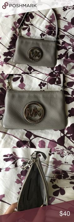 Michael kors wristlet Michael kors wristlet. Two small pockets on the inside (see above picture) a few small scratches on the metal MK (see above picture) can be seen when up close like in the picture but it is it not something you notice. Michael Kors Bags Clutches & Wristlets