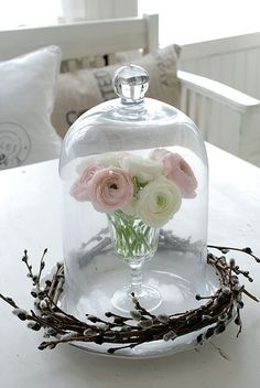 Cloches as Table Decorations   Adding another dimension here makes the flowers more of a centrepiece ...