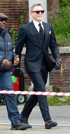 "Filming SPECTRE - Daniel Craig in TOM FORD ""Windsor"" black herringbone 3-piece peak lapel suit."